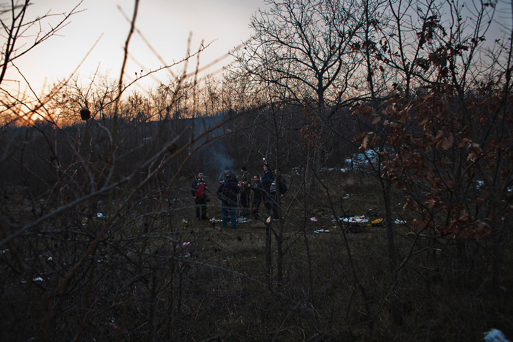 Men from Velika Hoca grill meat and fish in a field near the village while celebrating on Christmas Eve...Orthodox Christmas (January 7) in the Serbian village of Velika Hoca, Kosovo.