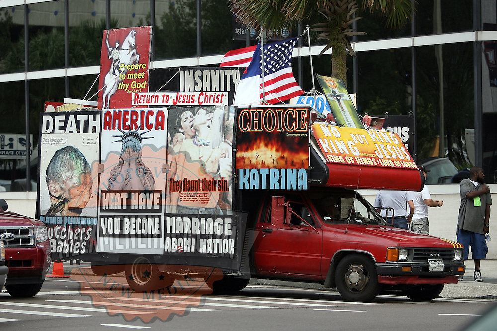 A truck with protest signs drives the city streets during the Republican National Convention in Tampa, Fla. on Wednesday, August 29, 2012. (AP Photo/Alex Menendez)