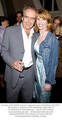 Actress JANE ASHER and her husband cartoonist GERALD SCARFE, at a party in London on 8th September 2002.PDB 10