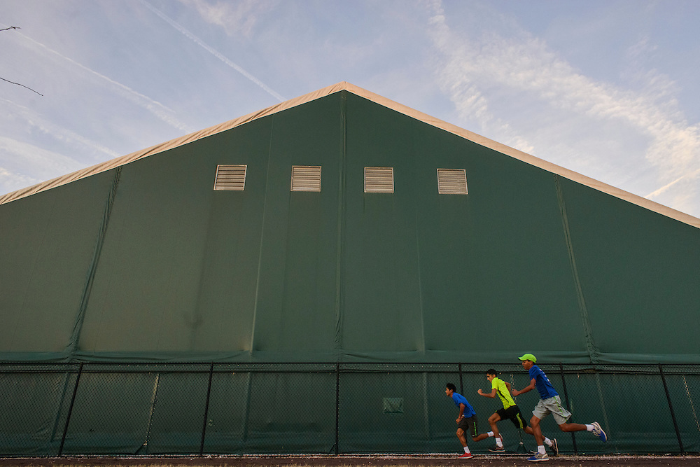 College Park, Maryland - December 19, 2013: Junior Tennis Champions Center tennis players Brian Tsao, 17, Curran Verman, 15, and Matthew Fenty, 13, sprint outside the Tennis Center at College Park's indoor tennis courts in Maryland December 19, 2013.<br /> <br /> CREDIT: Matt Roth for The New York Times<br /> Assignment ID: 30152047A