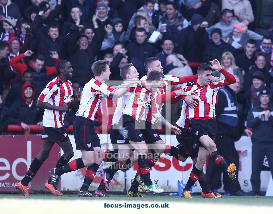 Picture by John  Rainford/Focus Images Ltd +44 7506 538356.27/01/2013.Marcello Trotta of Brentford celebrates with team-mates after scoring against Chelsea during the The FA Cup match at Griffin Park, London.