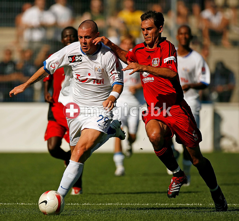 Manuel Friedrich (R) of Bayer 04 Leverkusen and FCZ's Eric Hassli (C) are running for the ball during a charity soccer game between Swiss FC Zuerich and Germany's Bayer 04 Leverkusen at the Hardturm stadium in Zurich, Switzerland, Saturday 14 July 2007. The charity game is dedicated to FC Zurich supporter Roland Maag who got badly hurt a year ago by unidentified hooligans  after a FC Zurich game. (Photo by Patrick B. Kraemer / MAGICPBK)