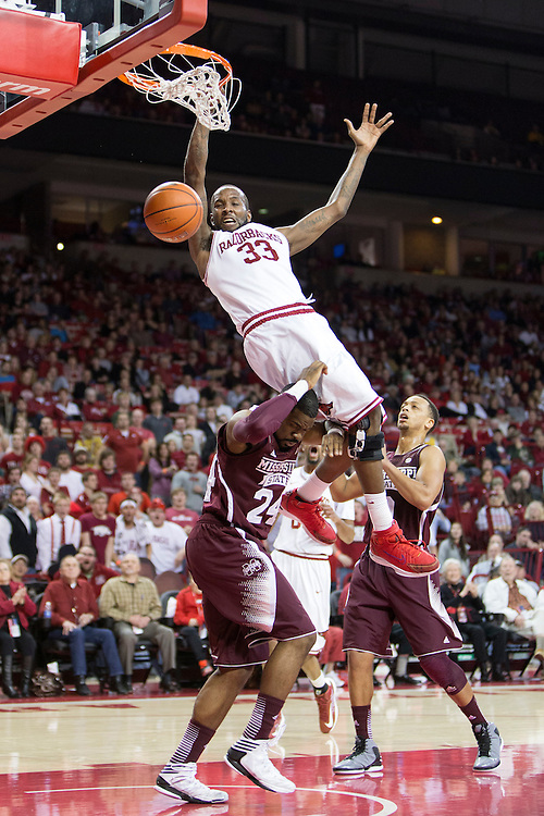 FAYETTEVILLE, AR - JANUARY 23:  Marshawn Powell #33 of the Arkansas Razorbacks goes up for a dunk over Trivante Bloodman #4 of the Mississippi State Bulldogs but is called for a charge at Bud Walton Arena on January 23, 2013 in Fayetteville, Arkansas. The Razorbacks defeated the Bulldogs 96-70.  (Photo by Wesley Hitt/Getty Images) *** Local Caption *** Marshawn Powell; Trivante Bloodman
