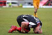 Grimsby Town defender Ben Davies (2) brought down during the EFL Sky Bet League 2 match between Grimsby Town FC and Port Vale at Blundell Park, Grimsby, United Kingdom on 10 March 2018. Picture by Mick Atkins.