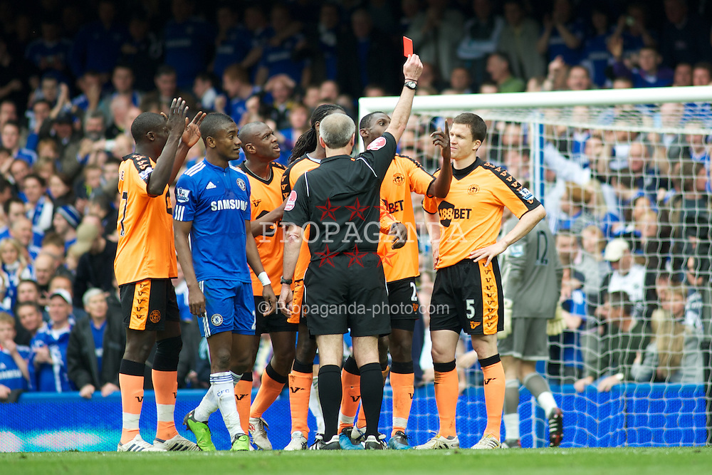 LONDON, ENGLAND - Sunday, May 9, 2010: Chelsea get a penalty after Wigan Athletic's Gary Caldwell is shown a straight red card for a foul on Frank Lampard during the final Premiership match of the season at Stamford Bridge. (Pic by Gareth Davies/Propaganda)