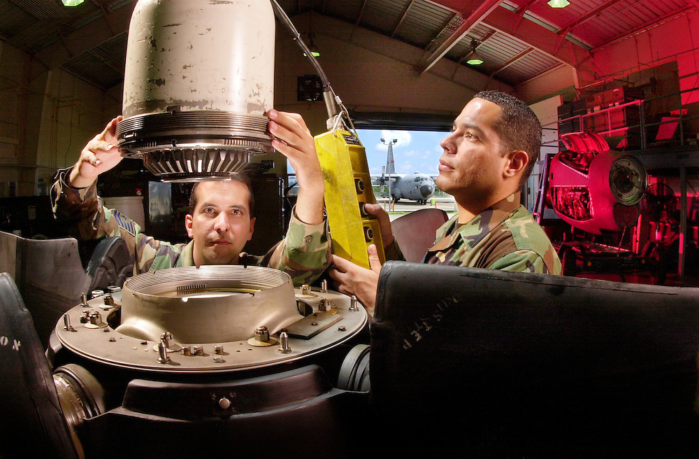 A C-130 turboprop must sit just right on the propeller hub assembly during a dome installation. Tech. Sgt. Raymond Gonzalez (front) and Staff Sgt. Yvhan Santiago, 156th Maintenance Squadron of the Puerto Rico Air National Guard make sure of that. Once, during an installation, Gonzalez found a prop that didn?t have a blade set properly. He fixed it. His catch could have prevented an accident.  http://www.af.mil/news/airman/0202/world8.html..by Tech. Sgt. Lance Cheung