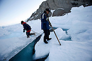 Sasa Samson 37 and Tomi Salovinik 19 , checking the ice next to the crack , to know from where thay can cross it on the way to hunt Seals in Resolute Bay. Tuesday June 12 2007