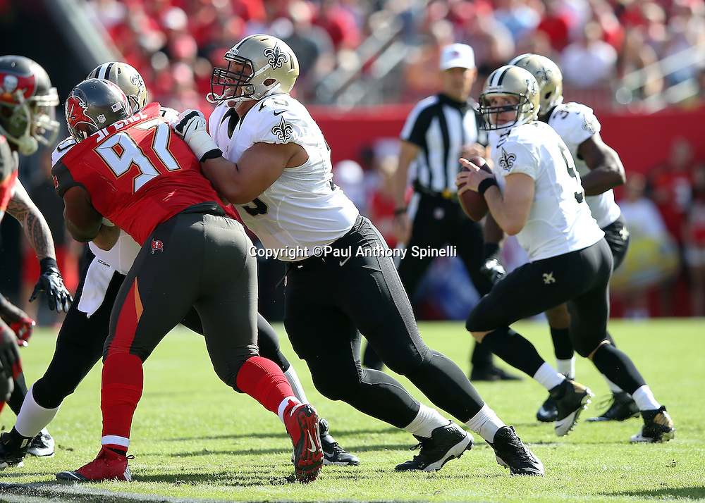 New Orleans Saints offensive tackle Andrus Peat (75) blocks Tampa Bay Buccaneers defensive tackle Akeem Spence (97) during the 2015 week 14 regular season NFL football game against the Tampa Bay Buccaneers on Sunday, Dec. 13, 2015 in Tampa, Fla. The Saints won the game 24-17. (©Paul Anthony Spinelli)