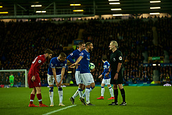 LIVERPOOL, ENGLAND - Sunday, March 3, 2019: Everton's Cenk Tosun and Gylfi Sigurdsson complain to referee Martin Atkinson during the FA Premier League match between Everton FC and Liverpool FC, the 233rd Merseyside Derby, at Goodison Park. (Pic by Laura Malkin/Propaganda)