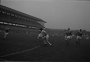21/02/1965<br /> 02/21/1965<br /> 21 February 1965<br /> Munster v Ulster Railway Cup semi-final at Croke Park. The final score was Ulster 0-14 Munster 0-9.<br /> Ulster's J. Carroll punches the ball over the bar for one of Ulster's 14 points.