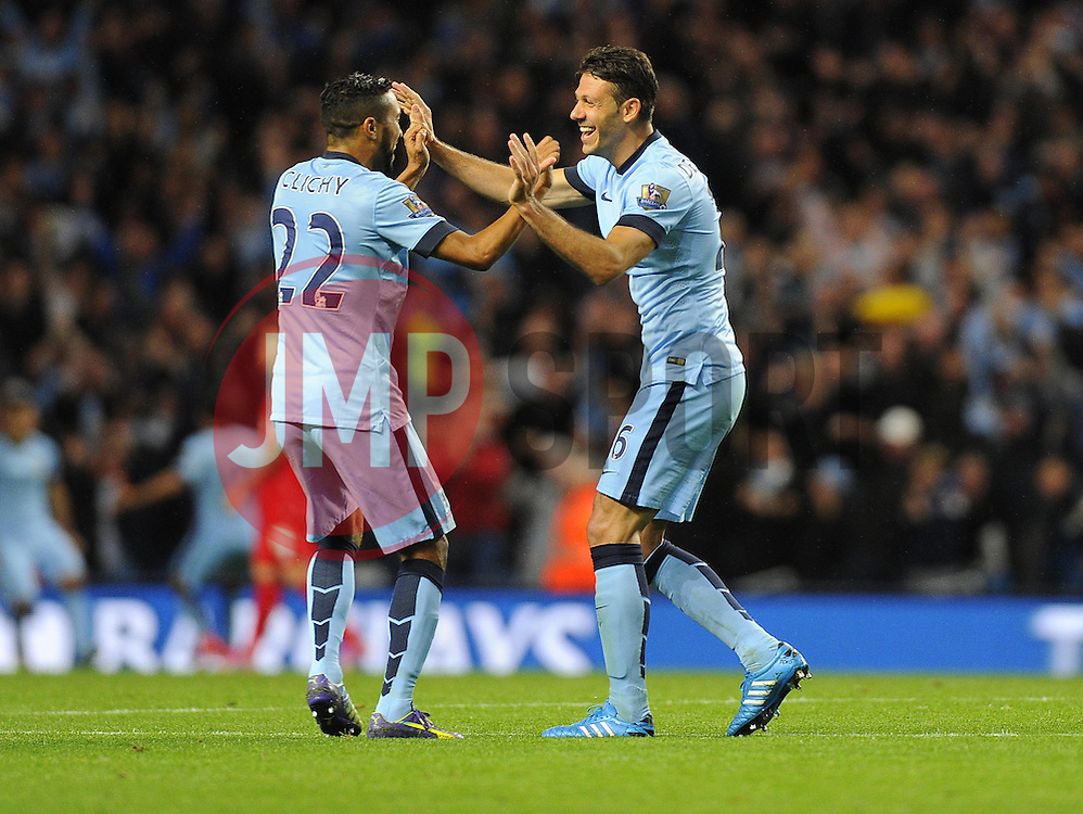 Manchester City's Martin Demichelis celebrates Manchester City's Sergio Aguero's goal with Manchester City's Gael Clichy - Photo mandatory by-line: Joe Meredith/JMP - Mobile: 07966 386802 25/08/2014 - SPORT - FOOTBALL - Manchester - Etihad Stadium - Manchester City v Liverpool - Barclays Premier League