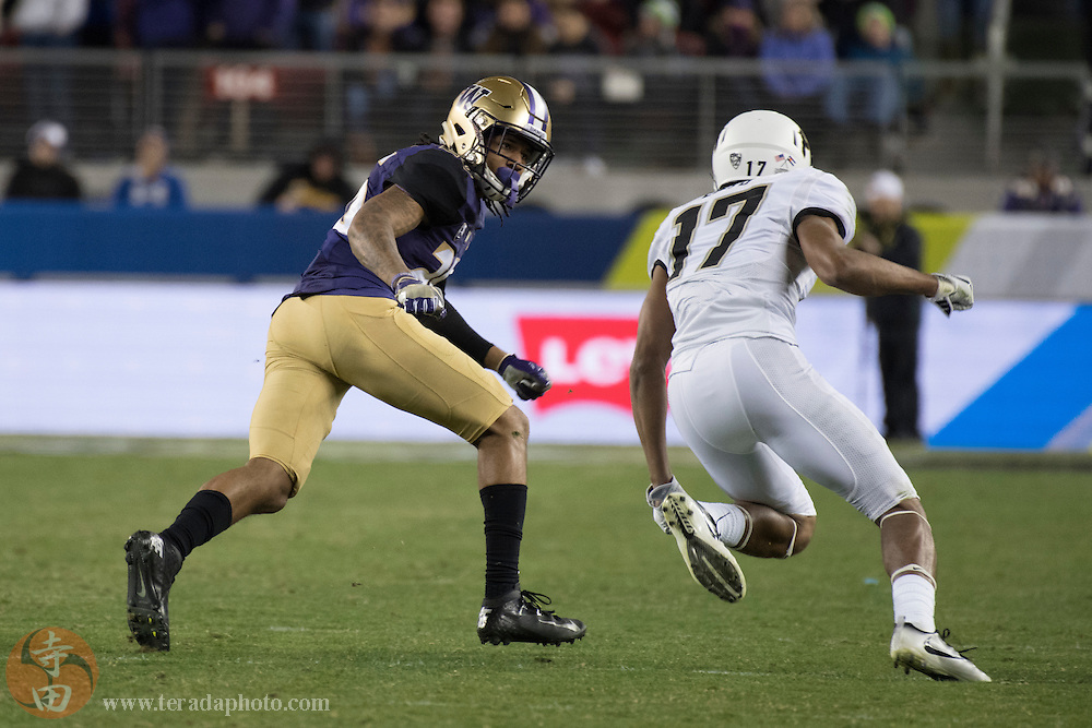 December 2, 2016; Santa Clara, CA, USA; Washington Huskies defensive back Sidney Jones (26) defends against Colorado Buffaloes wide receiver Kabion Ento (17) during the fourth quarter in the Pac-12 championship at Levi's Stadium. The Huskies defeated the Buffaloes 41-10.