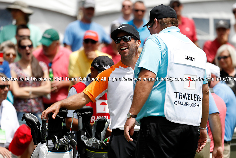 CROMWELL, CT - JUNE 24: Paul Casey of England  has a laugh with his caddie on the first tee during the third round of the Travelers Championship on June 24, 2017, at TPC River Highlands in Cromwell, Connecticut. (Photo by Fred Kfoury III/Icon Sportswire)