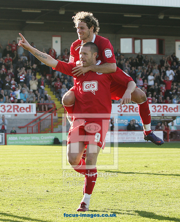 Picture by Paul Terry/Focus Images Ltd. 07545642257.24/03/12.Gary Alexander of Cawley Town celebrates with Sergio Torres after scoring from the penalty spot to make it 2-0 during the Npower League 2 match at Broadfield Stadium, Crawley.