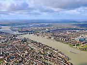 Nederland, Zuid-Holland, Dordrecht, 25-02-2020; centrum van Dordrecht met Grote Kerk (Onze-Lieve-Vrouwekerk) en zicht op de Oude Maas. Binnenstad met onder andere Nieuwe Haven, Wolwevershaven, Kuipershaven en Wijnhaven.<br /> Historical city center Dordrecht with Grote Kerk (Onze-Lieve-Vrouwekerk) and a view of the Oude Maas.<br /> <br /> luchtfoto (toeslag op standard tarieven);<br /> aerial photo (additional fee required)<br /> copyright © 2020 foto/photo Siebe Swart