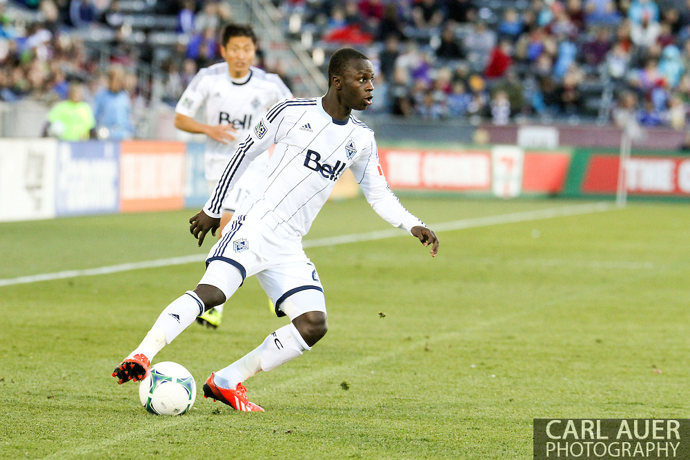 October 19th, 2013:  Vancouver Whitecaps FC forward Kekuta Manneh (23) controls the ball in the second half of action in the MLS Soccer Match between the Vancouver Whitecaps FC and the Colorado Rapids at Dick's Sporting Goods Park in Commerce City, Colorado
