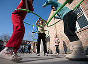 Children of  Migrant Workers play with Hula-Hoops  during Open House at the (name?) school. Open House is one of many programs offered by the CMC in Beijing.