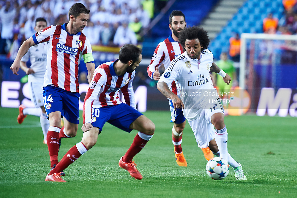 Marcelo (Real Madrid F.C.) and Gabi in action during the Champions League, round of 4 match between Atletico de Madrid and Real Madrid at Estadio Vicente Calderon on April 14, 2015 in Madrid, Spain