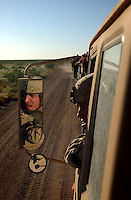 Spc. Miller, of Lewiston, Idaho, keeps an eye on the desert terrain Tuesday, Sept. 14, 2004 as he follows a convoy through Fort Bliss, Texas. Miller is one of the 1,600 National Guard troops that have been activated for a November deployment to Iraq.