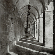 A long corridor on the Temple Mount of Jerusalem, Israel shows alternating sections of light and darkness. This image was created using the Bromoil process.