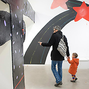 "March 10, 2012 - New York, NY : Monty Pera walks his daughter, India, through the partially complete Misaki Kawai exhibit, ""Love from Mt. Pom Pom,"" at the Children's Museum of the Arts in the south village on March 10. CREDIT: Karsten Moran for The New York Times"