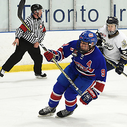TORONTO, ON  - NOV 26,  2017: Ontario Junior Hockey League game between the Toronto Jr. Canadiens and the Toronto Patriots, Jake Joffe #9 of the Toronto Jr. Canadiens follows the play during the second period.<br /> (Photo by Andy Corneau / OJHL Images)