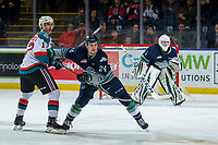 KELOWNA, CANADA - JANUARY 30:  Jake Lee #24 of the Seattle Thunderbirds checks Alex Swetlikoff #17 of the Kelowna Rockets during second period on January 30, 2019 at Prospera Place in Kelowna, British Columbia, Canada.  (Photo by Marissa Baecker/Shoot the Breeze)
