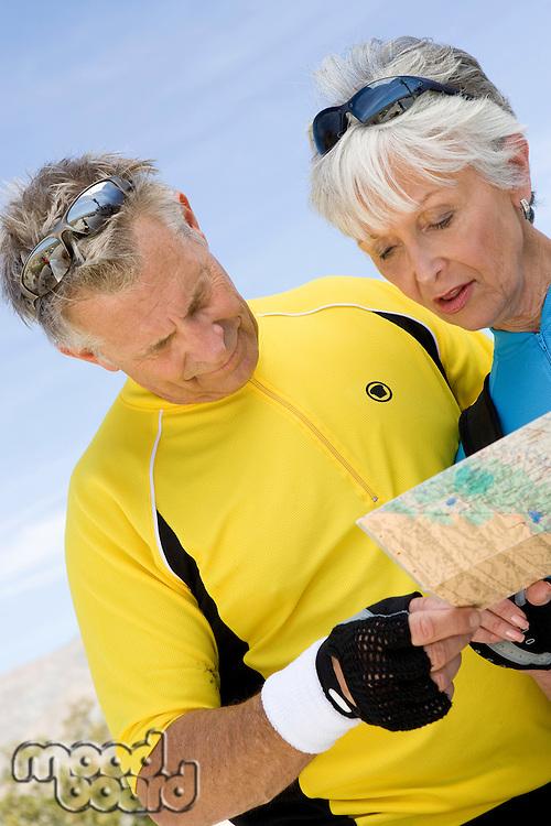 Senior couple reading map