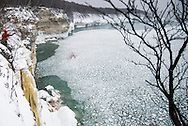 Ice climbing along the coast of Lake Superior at Pictured Rocks National Lakeshore on Michigan's Upper Peninsula near Munising, Michigan USA.
