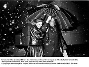 Susan and John Gutfreund brave the elements as they arrive at a gala at Alice Tully Hall attended by Hillary Rodham Clinton. New York. 21 February 1993. Film 93197f20<br />© Copyright Photograph by Dafydd Jones<br />66 Stockwell Park Rd. London SW9 0DA<br />Tel 0171 733 0108