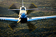"Spectacular color photographic image of a P-51 Mustang ""Cripes A' Mighty"" taken air to air over the Arizona desert"