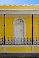 Arched door on yellow building