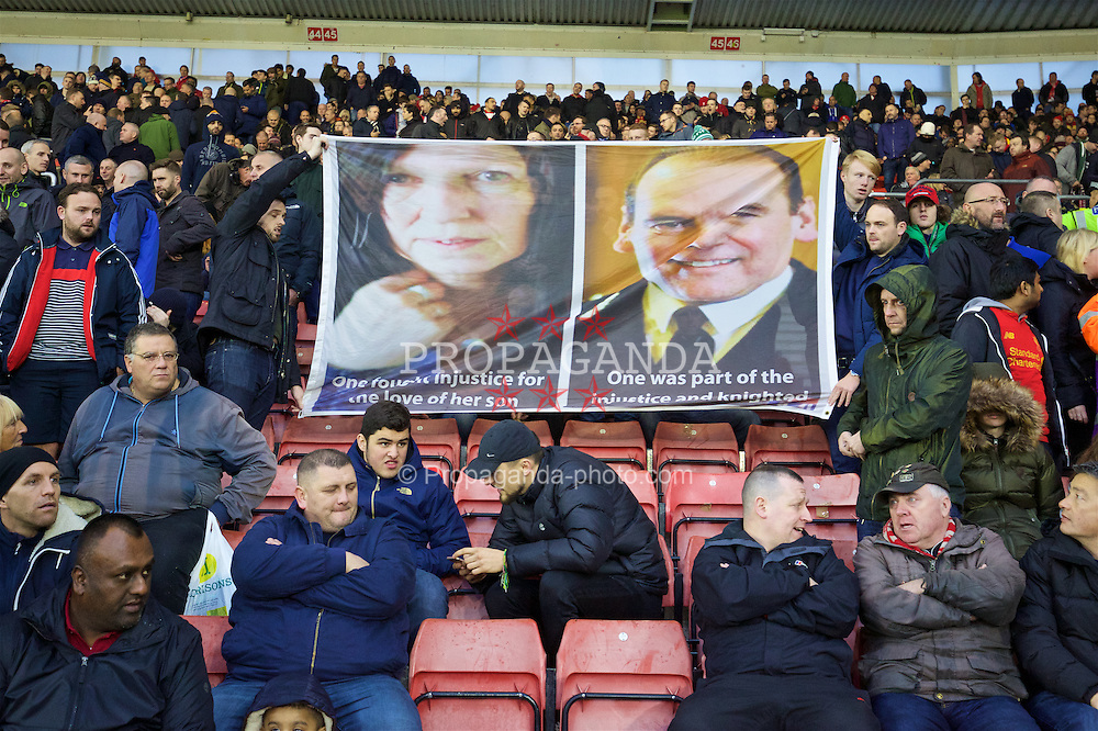 SOUTHAMPTON, ENGLAND - Saturday, November 19, 2016: Liverpool supporters with a banner featuring Hillsborough Justice campaigner Ann Williams and South Yorkshire police's Norman Bettison during the FA Premier League match against Southampton at St. Mary's Stadium. (Pic by David Rawcliffe/Propaganda)