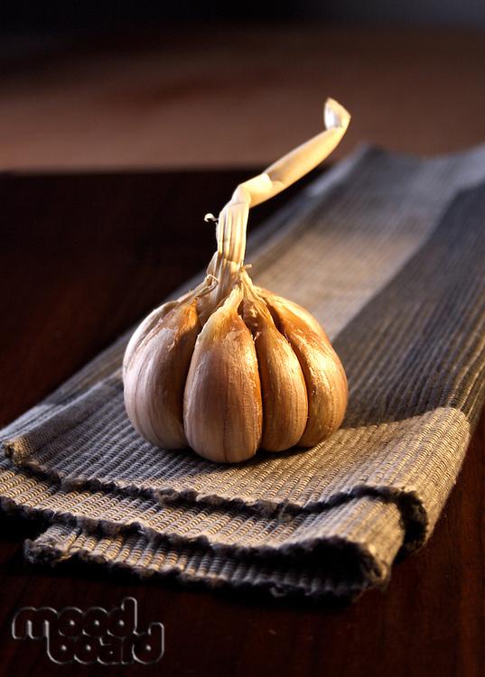 Studio shot of garlic on cloth
