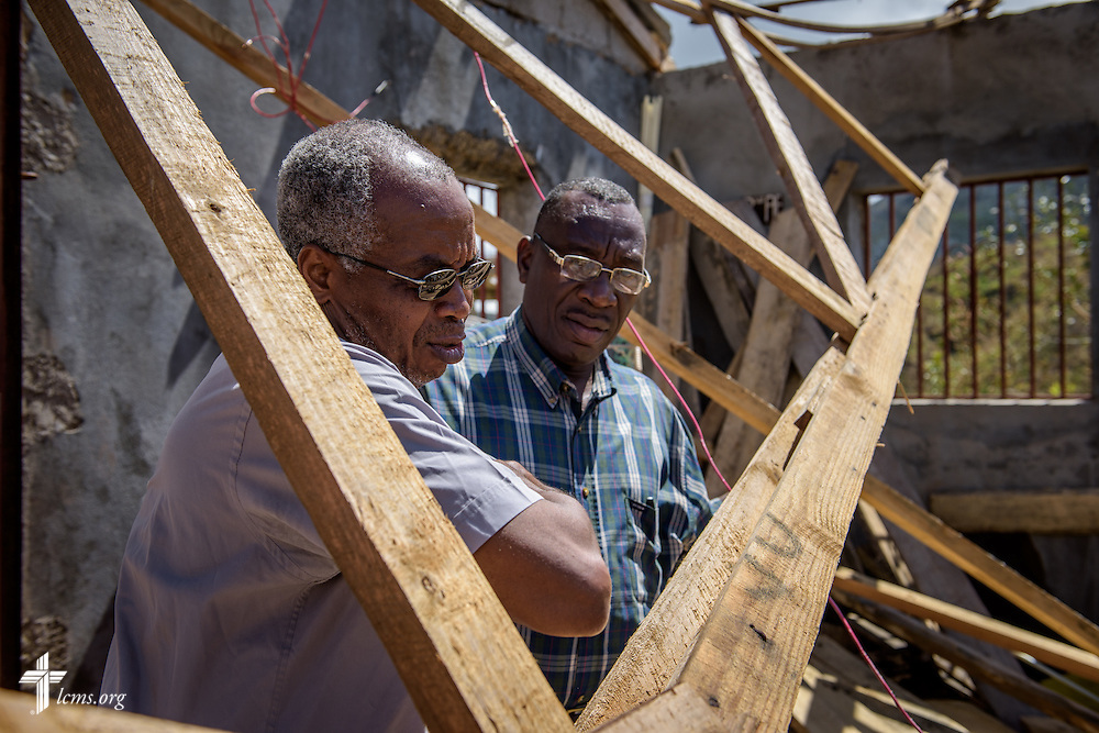 The Rev. Paul Toulette, pastor in Les Cayes, and the Rev. Eliona Bernard, president of The Evangelical Lutheran Church in Haiti, stand together in a Lutheran parish destroyed by Hurricane Matthew on Wednesday, Oct. 12, 2016, in Duchity, Haiti. LCMS Communications/Erik M. Lunsford