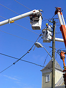 """electric utility lineman""   bucket-truck high ""cutting electrical wires"" working hardhat hazardous job work"