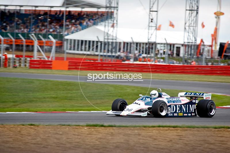 Car No 36 heads around Luffield. Silverstone Classic - 66-85 F1- 25/7/10.