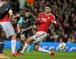 MANCHESTER, ENGLAND - Wednesday, March 16, 2016: Liverpool's Philippe Coutinho Correia in action against Manchester United's Chris Smalling during the UEFA Europa League Round of 16 2nd Leg match at Old Trafford. (Pic by David Rawcliffe/Propaganda)