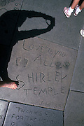 Footograph: Photograph of my right foot by Shirley Temple's footprint and autograph at TCL Chinese Theatre (formerly Grauman's Chinese Theatre, and Mann's Chinese Theatre), a movie theater on the historic Hollywood Walk of Fame at 6925 Hollywood Boulevard in Hollywood, California.