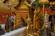 Pilgrims circumambulate the inner Chedi at Wat Phra That Doi Suthep bearing lotus blooms, Chiang Mai, Thailand