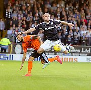 Dundee's James McPake dominates against Dundee United's Darko Bodul - Dundee United v Dundee at Tannadice<br /> - Ladbrokes Premiership<br /> <br />  - &copy; David Young - www.davidyoungphoto.co.uk - email: davidyoungphoto@gmail.com