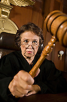 Judge using gavel in court