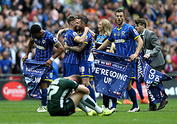 AFC Wimbledon celebrate Promotion to League One after winning the League Two Playoff Final as Craig Tanner of Plymouth Argyle looks dejected - Mandatory by-line: Robbie Stephenson/JMP - 30/05/2016 - FOOTBALL - Wembley Stadium - London, England - AFC Wimbledon v Plymouth Argyle - Sky Bet League Two Play-off Final