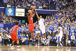 UK forward Terrence Jones, right, blocks a shot by Ole Miss guard Jarvis Summers in the first half. UK hosted Ole Miss Saturday, Feb. 18, 2012 at Rupp Arena in Lexington . Photo by