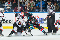 KELOWNA, CANADA - OCTOBER 3: James Malm #14 of the Vancouver Giants struggles for the puck after the face off against Kyle Topping #24 of the Kelowna Rockets  on October 3, 2018 at Prospera Place in Kelowna, British Columbia, Canada.  (Photo by Marissa Baecker/Shoot the Breeze)  *** Local Caption ***