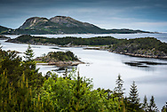 Namsos, Namdal, Trondelag, Norway, July 2015. The wild mountain and fjord landscapes of the Otteroya peninsula. Trøndelag lies at the heart of Norway's identity. The rolling hills of the interior with its traditional ox-blood coloured farm houses grow a wealth of produce. In the west the coastline is sculpted by a maze of fjords and islands home to small fishing communities. Photo by Frits Meyst / MeystPhoto.com