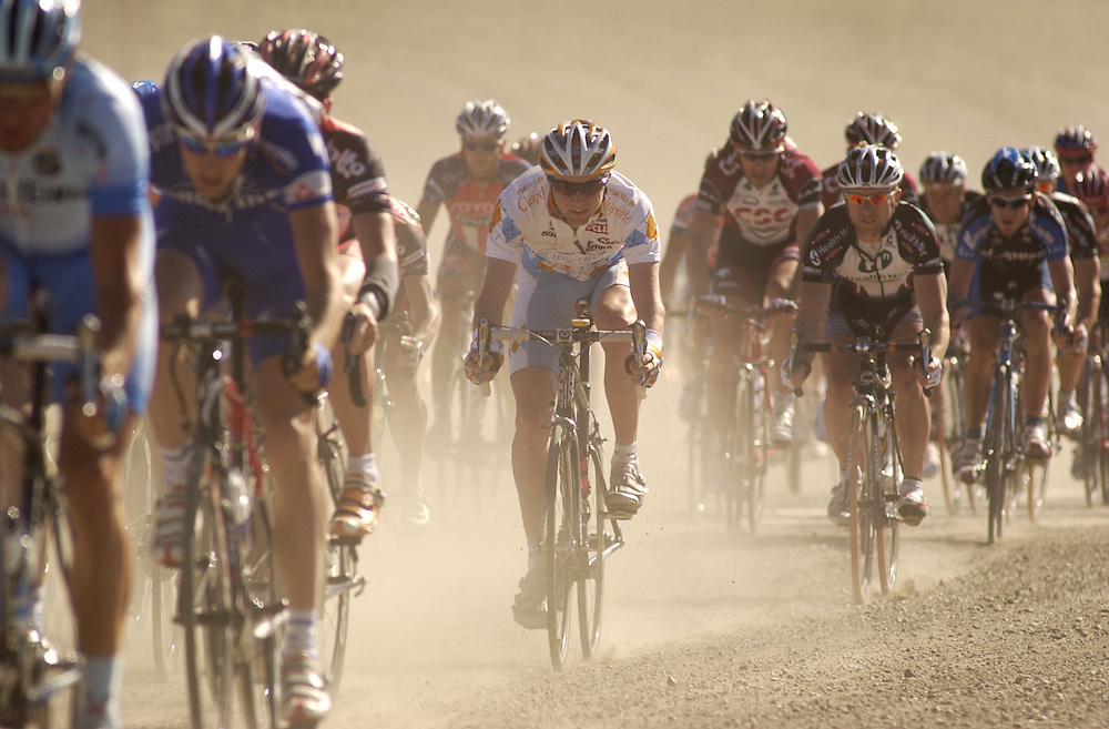 Riders in the Amgen Tour of California bike race ride over a gravel road as it passes through Fillmore on Saturday.