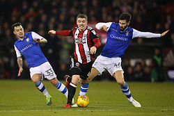 John Fleck of Sheffield United goes past Ross Wallace and Frederico Venancio of Sheffield Wednesday - Mandatory by-line: Robbie Stephenson/JMP - 12/01/2018 - FOOTBALL - Bramall Lane - Sheffield, England - Sheffield United v Sheffield Wednesday - Sky Bet Championship