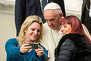 Two women take a selfie with Popr Francis during his weekly general audience at the Paul VI hall on January 10, 2018 at the Vatican.