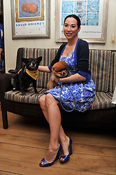 ALEX MEYERS with her dog Ribbons and Dolly Beddow at The Dog's Trust Awards announcement held at George, 87-88 Mount Street, London on 27th March 2012.
